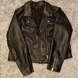 Slightly used fake leather jacket